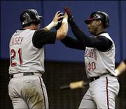 Cincinnati's Sean Casey, left, congratulates teammate Ken Griffey Jr. after Griffey hit a two-run home run against Montreal. The Reds defeated the Expos, 7-6, Friday night in Montreal.