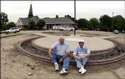 Erv Hodges, left, and Walter Hicks have helped to spearhead the Veterans Memorial project at the Lawrence Visitor Center, 402 N. Second St. The two are pictured on Wednesday at the construction site.
