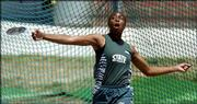 Free State High's Samantha Houston unfurls a throw in the discus competition at the state tournament. Houston placed third Friday in Wichita.
