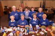 Members of AARP's Lawrence chapter 1696 pose for a picture at the American Legion, 3408 W. Sixth St. They gathered May 13 to prepare and send care packages to the soldiers serving in Iraq. Pictured are, from left back row, Mary Kanous, Darlene Hill, Janice Whitham, Phyllis Cross and Lauraine Mulally; front row from left, Thelma Hehn, Marilyn McCleary, Suzanne McColl and Jane Pracht.