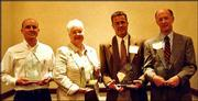 Representatives from organizations receiving the 2003 Spirit of Caring Awards are, from left, Richard Chappelle, Wal-Mart store 484; Dee Bisel, Minuteman Press; Todd Harris, Peoples Bank; and Ted Haggart, Douglas County Bank. On April 23, the United Way of Douglas County and the Lawrence Chamber of Commerce recognized local businesses that are leaders in strengthening the Douglas County community through charitable giving and the promotion of volunteerism.
