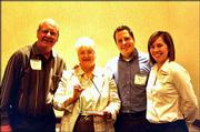 From left, Ron Bisel, his wife Dee Bisel, owner of Minuteman Press, and their children Ryan Bisel and Adele Bisel accept the 2003 Spirit of Caring Award in the sole proprietor category. They received the honor April 23 during a Leadership Lawrence Celebration at the SpringHill Suites by Marriott.