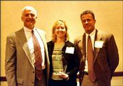 rom left, Wint Winter, Michelle Fales and Todd Harris, representatives of Peoples Bank, accept the Spirit of Caring Award for a small business. They received the award April 23 at the SpringHill Suites by Marriott. The award is given by the United Way of Douglas County and the Lawrence Chamber of Commerce.