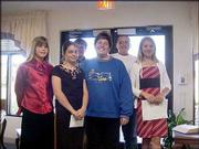 From left are Katie Markle, Olathe; Emily Robert, Lawrence; Josh Markle, Olathe; Debbie Ellebracht, Lawrence; Erik Anderson, Lawrence; and Ali Jacobsen, Lawrence. Ellebracht's piano students gave a recital on May 14 at Brandon Woods Retirement Community. They gave the recital in honor of National Nursing Home Week, which was May 9-15.