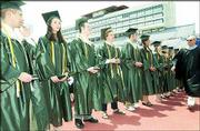 The 17 valedictorians in the Free State High School Class of 2004 receive honors during a commencement ceremony. From left, Ryan Bodensteiner, Jessica Carlyle, Thomas Duermeier, Evan Ferrier, Brian Garland, Jennifer Gwaltney and Anne Laue-Minden, Hazel Morley and Dominique Nunez can be seen. At right is Supt. Randy Weseman. The ceremony was May 15 at Memorial Stadium.