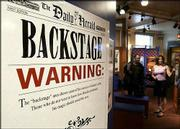 "A sign warns that the Houdini trick ""Metamorphosis"" will be revealed at the Outagamie Museum."