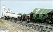 Derailed freight cars line the railroad tracks near Wright, just east of Dodge City. Strong winds Wednesday knocked 68 empty grain cars on the Burlington Northern-Santa Fe train off the tracks. No one was injured.