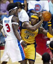 Detroit center Ben Wallace, left, smothers Indiana's Al Harrington during the Eastern Conference Finals. The defensive-oriented Pistons play the Lakers in the NBA Finals starting Sunday.