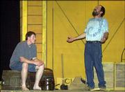 "Adam Canterbury, Baldwin, as Huck, left, and Ed Lammer, Ottawa, Huck&squot;s father, right, rehearse a scene from ""Big River."" The Baldwin City Community Theatre is staging the Broadway musical based on Mark Twain&squot;s ""Adventures of Huckleberry Finn"" at Baldwin Junior High."