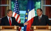President Bush answers a question during a news conference with French President Jacques Chirac at the Elysee Palace in Paris.
