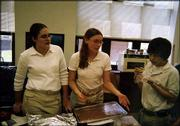 "Jeff Miller, right, samples food made for the Bishop Seabury Academy journalism bake sale while Laura Gauch, left, and Erin Levy look on. The three students were ninth-graders in 2003-2004.<br> <a href= ""http://etc.lawrence.com/galleries/may2004teen/2938_lores.html"" target=""_new"" onclick= ""window.open(&squot;http://etc.lawrence.com/galleries/may2004teen/2938_lores.html&squot;,&squot;Photo&squot;,&squot;height=600,width=600,screenX=10,screenY=10,&squot; + &squot;scrollbars,resizable&squot;); return false;""> <img src=""http://www.ljworld.com/art/icons/icon_photo.gif"" border= ""0"" alt=""photo"">  Photo gallery: School&squot;s out</a><br>"