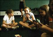 "From left, Wendy Hamm, Madison Brumley and Jordan Noll -- all fourth-graders -- play UNO on the last day of school at Lawrence Catholic Schools.<br> <a href= ""http://etc.lawrence.com/galleries/may2004teen/2938_lores.html"" target=""_new"" onclick= ""window.open(&squot;http://etc.lawrence.com/galleries/may2004teen/2938_lores.html&squot;,&squot;Photo&squot;,&squot;height=600,width=600,screenX=10,screenY=10,&squot; + &squot;scrollbars,resizable&squot;); return false;""> <img src=""http://www.ljworld.com/art/icons/icon_photo.gif"" border= ""0"" alt=""photo"">  Photo gallery: School&squot;s out</a><br>"