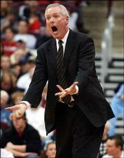Ohio State coach Jim O'Brien reacts to an official's call in this December 2003 photo. Ohio State fired O'Brien on Tuesday for alleged NCAA violations.