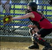 Lawrence Fast pitch Red team's Abbey Lindelof catches pitch against the Yellow team. Sunday night's double header was played at Holcom Sports Complex.