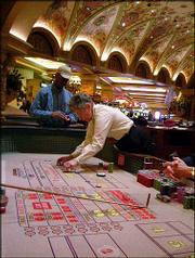 "Sharon Nyman works the craps table in this scene from the Discovery Channel&squot;s ""American Casino,"" at the Green Valley Ranch Casino in Las Vegas, in this undated publicity photo."
