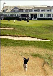 A golfer hits from the rough on the 16th fairway at Shinnecock Hills. The course in Southampton, N.Y., is at an exclusive country club in the Hamptons. It will be the site of the U.S. Open beginning Thursday.