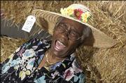 """""""How-dee!"""" exclaims Minnie Pearl Thomas, of Lawrence. The 83-year-old, known by most as simply Minnie Pearl, was well-liked long before her name become famous on television's """"Hee Haw."""" She spends most of her time these days on her east Lawrence porch, watching life unfold."""