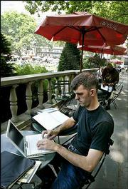 Chuck Upchurch, of New York, does academic research on his laptop computer using the free Wi-Fi connection in New York's Bryant Park. Upchurch took advantage of the free service last week. Small companies, some publicly traded, are trying to turn Wi-Fi into viable businesses.