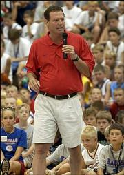 Kansas University men's basketball coach Bill Self talks to youngsters at his camp. Tuesday was the second day of the camp at Horejsi Center.