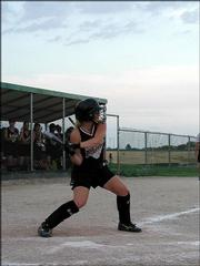 Lawrence Phenix pitcher Courtney Johnson takes a swing against the Saints. The 16-U Saints defeated the 14-U Phenix, 11-3, Saturday in a tournament in Basehor.