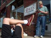 "A wandering, all-day reading of James Joyce&squot;s ""Ulysses"" begins outside the Raven Bookstore, 6 E. Seventh St., on the 100th anniversary of the date on which the book is set. Rich Ring, Lawrence, at right, was one of the participants who read aloud from the book Wednesday."