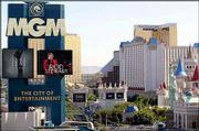 A sign for the MGM Grand towers above the Las Vegas Strip in front of the gold towers of the Mandalay Bay Resort & Casino, the pyramid of the Luxor and the castle-themed Excalibur, all owned by the Mandalay Resort Group. Boards for Mandalay Resort Group and MGM Mirage approved late Tuesday a $4.8 billion offer that would merge the two firms.