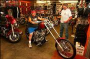 "Mike Munoz, Topeka, checks out a Hardcore II 2004 Kit Bike at Hog Works in Big Springs as the store&squot;s owner, Randy Lester, looks on. The store is among motorcycle stores across the nation that have benefited from the reality-television show ""American Chopper."""