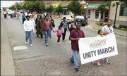 Dozens of people participate in a Unity March down Massachusetts Street. Saturday's march was part of the Juneteenth celebration, which recognizes the end of slavery.