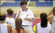 Kansas University women's basketball coach Bonnie Henrickson speaks to participants in her Elite Camp. The camp was Saturday at Allen Fieldhouse.