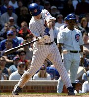 Chicago's Michael Barrett connects for a game-winning double against Oakland. The Cubs defeated the Athletics, 4-3, Saturday in Chicago.