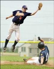 Lawrence Outlaws runner Paul Foltz (11) steals second base as Olathe East's Jeff Lubeck leaps for the throw. The Outlaws swept a doubleheader Saturday at Eudora High.