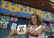 Katie Wolff, Kansas University senior from Shawnee and Rock the Vote street team coordinator, poses in front of The Bottleneck, 737 N.H. Rock the Vote is going to area clubs to register young people to vote in the upcoming elections.