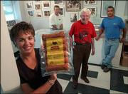 From left, Roberta Lehmann, her brother Pat Pyle, her father, Tom Pyle, and her brother Tom Pyle Jr., operate Pyle Meat Co. The family-owned Eudora company is one of several area producers of sausage.