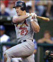 Scott Rolen drives the ball down the third-base line for a three-run double in the third inning. Rolen powered the Cardinals to a 5-2 victory over the Royals on Friday in Kansas City, Mo.