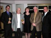 Steve Steinbach, left, and Dick Leines, second from the left, hold their 2004 Caring & Commitment Awards for their significant contributions to Cottonwood Inc. They have worked for the organization for more than 10 years. They posed with Cottonwood Inc. executive director Sharon Spratt and the presidents of the Cottonwood Foundation and Cottonwood Inc. board of trustees, John Tacha and Kelly Drake. They received the honors during the Cottonwood Classies on April 26 at Lawrence High School.