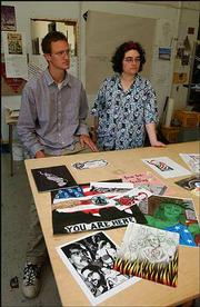 """Tony Young and Chantel Guidry, members of Lawrence Anarchist Black Cross, display a collection of art by people in American prisons. The work will be on view through July in """"Freedom Unbound: Art from within American Gulags,"""" at 4-1-1 Studio, 411 E. Ninth St."""