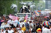 Thousands of men and women crowd Mexico City's central avenue Saturday to celebrate gay pride and demand equal rights.