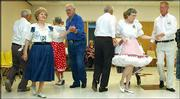 Square dancers go through a formation during the State Promenaders' dance in Hutchinson. Square dancing offers socializing and exercising in a good clean environment with no smoking, swearing or drinking.