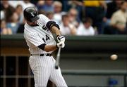 Paul Konerko of the White Sox connects for a three-run home run. The White Sox defeated the Cubs, 6-3, Saturday at U.S. Cellular Field in Chicago.