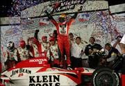 Dan Wheldon, winner of the SunTrust Indy Challenge, celebrates in victory lane. Wheldon won the race Saturday at Richmond International Raceway in Richmond, Va.
