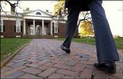 A visitor walks toward the entrance to Thomas Jefferson's home Monticello in Charlottesville, Va. The home hosts half-million visitors annually.