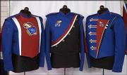"A display at Fruhauf Uniforms shows three distinct looks that each Kansas University band uniform can have. The interchangeable jackets and capes are all tied together with black pants and helmets.<br> <a onclick= ""window.open(&squot;http://etc.lawrence.com/galleries/featherflock/3308_lores.html&squot;,&squot;Photo&squot;,&squot;height=650,width=750,screenX=10,screenY=10,&squot; + &squot;scrollbars,resizable&squot;); return false;"" target=""_new"" href= ""http://etc.lawrence.com/galleries/featherflock/3308_lores.html""><img alt=""*"" border=""0"" src=""http://www.kusports.com/art/icons/icon_photo.gif""> Photo gallery: New uniforms arrive</a><br>"