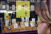 A passer-by looks at an advertisement for wine containers Monday in Paris. French winemakers want an end to restrictions on wine advertising to combat declining sales.