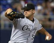 Chicago's Mark Buehrle delivers against Minnesota. Buehrle and the White Sox defeated the Twins, 6-2, Tuesday night in Minneapolis.