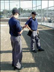 Umpires Aaron Abramovitz, left, and Taylor Worthington prepare to start a Douglas County Amateur Baseball Association game between the Stallions and the Spirit, June 24, at 4-H Cowser field.