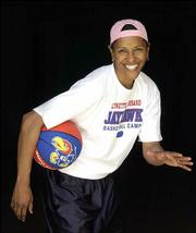 Legendary basketball player Lynette Woodard's list of accomplishments includes being the first female member of the Harlem Globetrotters, winning an Olympic Gold medal in 1984, and being a four-time Kodak All-American at Kansas University. Woodard, who will be inducted to the into the Naismith Memorial Basketball Hall of Fame on Sept. 10, struck an impromptu pose Wednesday in Allen Fieldhouse.