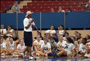 Lynette Woodard speaks to a crowd of basketball campers. Woodard, who will be inducted into the Naismith Memorial Basketball Hall of Fame on Sept. 10, addressed the camp Wednesday at Allen Fieldhouse.