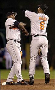 Baltimore's Miguel Tejada, left, and Melvin Mora do a victory dance after beating Kansas City. The Orioles won, 3-2, Thursday in Kansas City, Mo.
