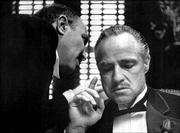 "Bonasera, left, portrayed by Frank Puglia, asks Don Vito Corleone, portrayed by Marlon Brando, for a favor in a scene from the 1972 movie ""The Godfather."" Brando, acclaimed as the greatest actor of his generation, died Thursday at age 80."