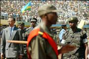 Paul Kagame, president of Rwanda, left, inspects military troops in the Amahoro stadium in Kigali to mark Liberation Day. Sunday's ceremony in Rwanda's capital took place to celebrate the fall of Kigali to the Rwandan Patriotic Front 10 years ago.
